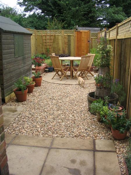 Circular traditions a small low maintenance victorian for Medium back garden designs