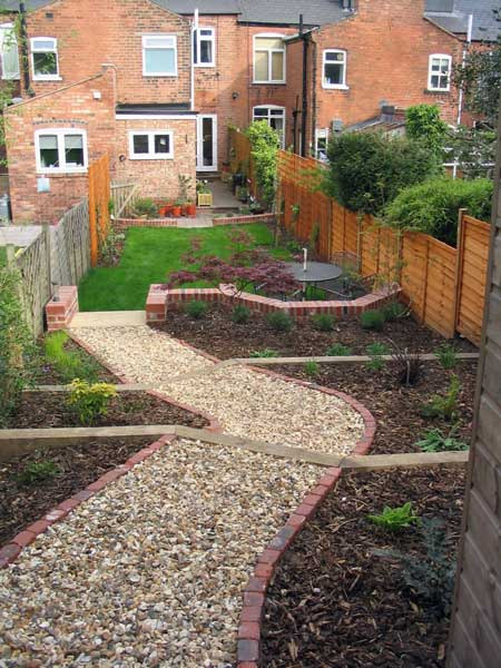 Leafy retreat a long narrow partially sloping garden for Small narrow garden designs